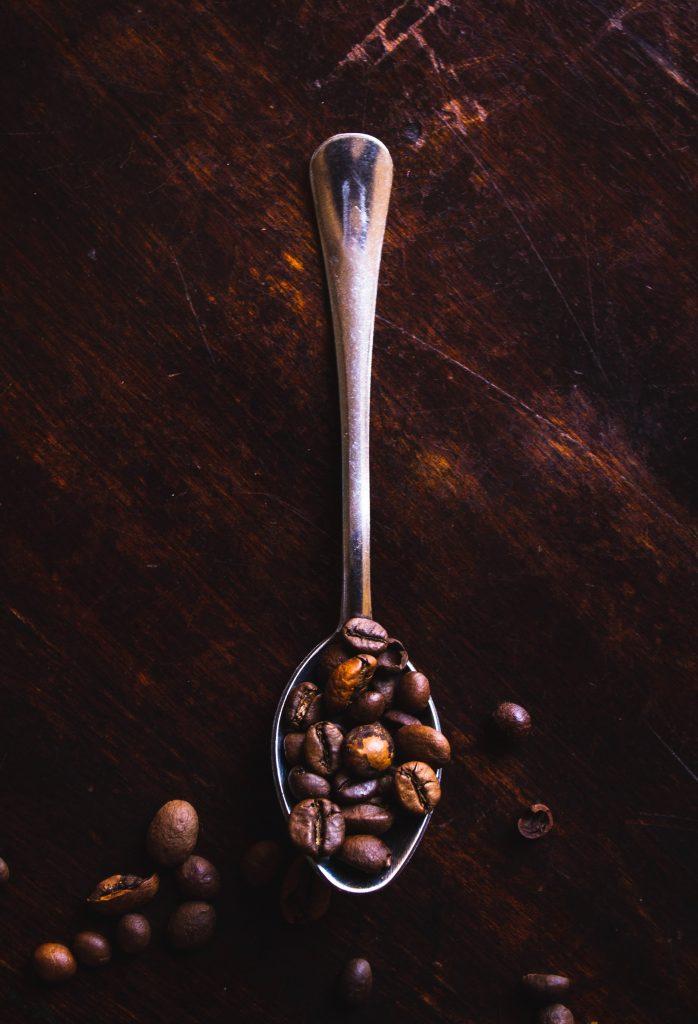 Arabica Coffee Beans on a spoon